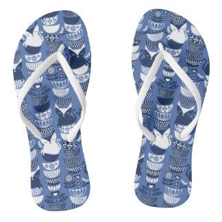 Swedish folk cats I // Indigo blue background Flip Flops