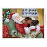 Sweet Dachshunds resting on Santa's Lap Greeting Card