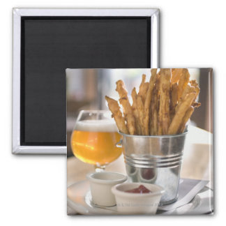 Sweet potato fries served with vinegar and magnet