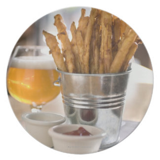 Sweet potato fries served with vinegar and plate