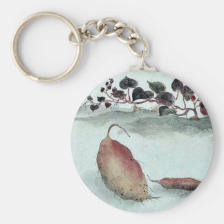 Sweet potato with plant growing in the background key ring
