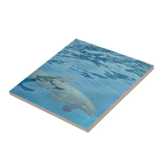 Swimming dolphin small square tile