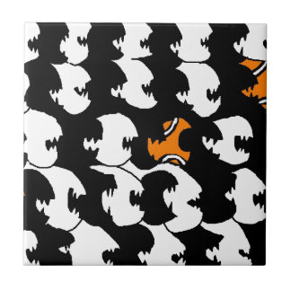 swimming in a sea of black small square tile