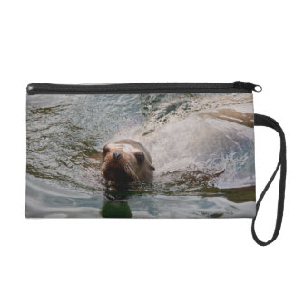 Swimming seal wristlet clutches
