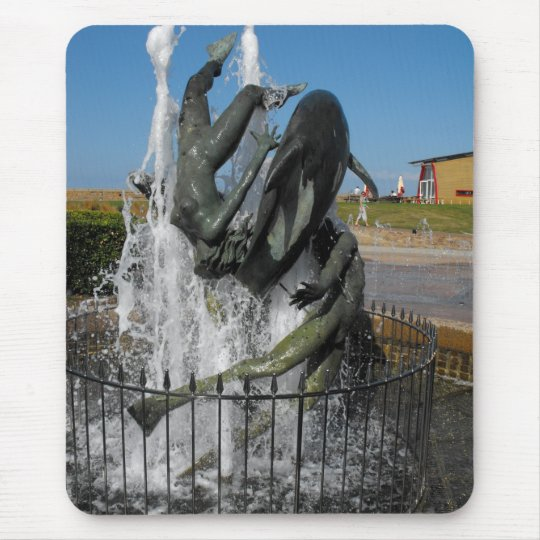 Swimming with dolphins fountain mouse pad