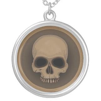 Symmetricus skull necklace. round pendant necklace