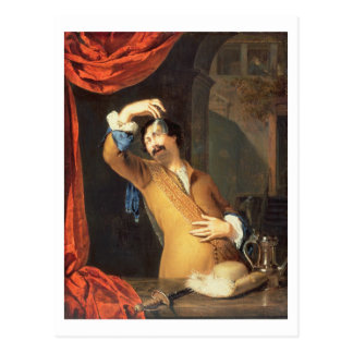 T31553 A Cavalier Standing at a Window Examining a Postcard