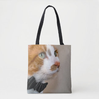 Tabby cat with bow tie tote bag