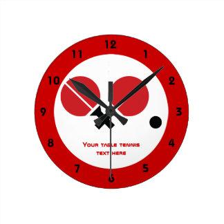 Table tennis ping-pong rackets and ball black, red wall clocks