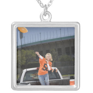 Tailgating woman throwing football silver plated necklace