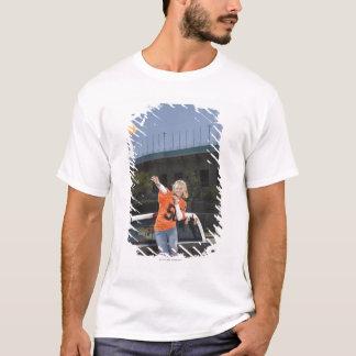 Tailgating woman throwing football T-Shirt