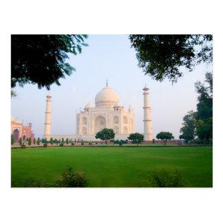 Taj Mahal at sunrise one of the wonders of the Postcard