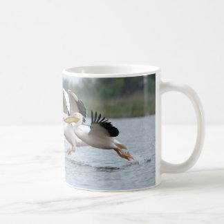 Taking off coffee mug