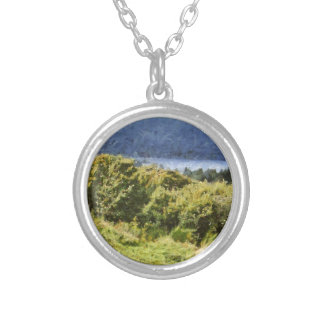 Tall bushes on shore of a lake round pendant necklace