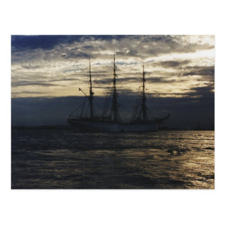 Tall ship in the evening postcard