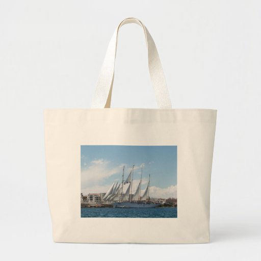 Tall Ship Sailing Out Of Harbor Tote Bags