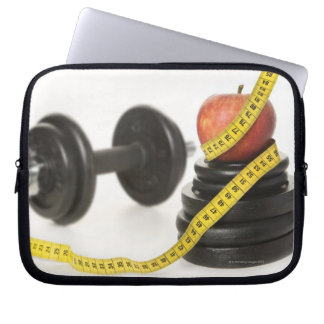 Tape measure, apple, dumbbell and weights laptop sleeve