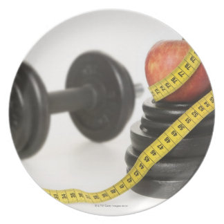 Tape measure, apple, dumbbell and weights plate