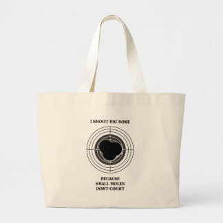 Target with large bullet holes - big bore jumbo tote bag