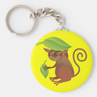 Tarsier hiding under a green leaf basic round button key ring
