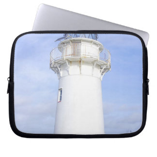 Te Araroa, New Zealand. A lighthouse gives Laptop Sleeve