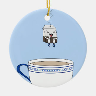 Tea bag jumping in cup round ceramic decoration