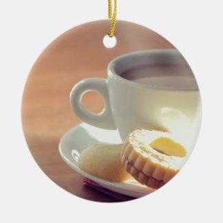 Tea with biscuit round ceramic decoration