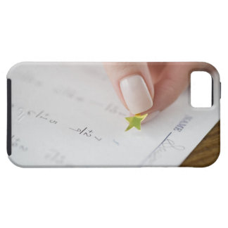 Teacher affixing gold star to math worksheet iPhone 5 covers