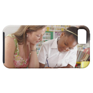 Teacher and school child working in classroom iPhone 5 cover