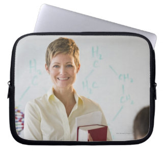 Teacher and student in science lab laptop sleeve