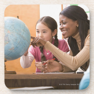 Teacher and student looking at globe coaster