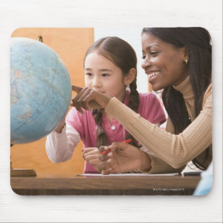 Teacher and student looking at globe mouse pad