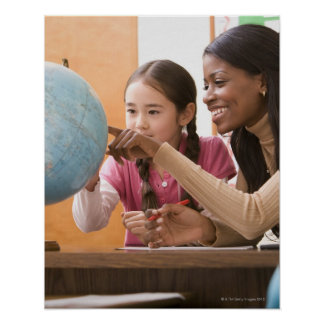 Teacher and student looking at globe poster