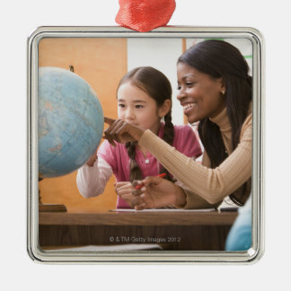 Teacher and student looking at globe Silver-Colored square decoration