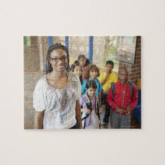 Teacher and students in school hallway jigsaw puzzle