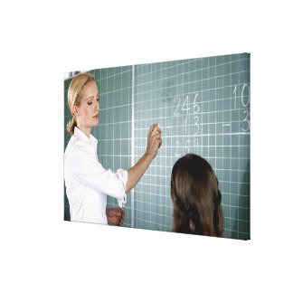 teacher and young girl in front of blackboard in canvas print