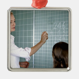teacher and young girl in front of blackboard in Silver-Colored square decoration