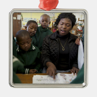 Teacher assists a group of learner's in the christmas ornament