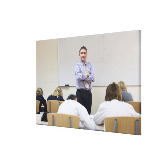 Teacher at front of class, children working hard gallery wrap canvas