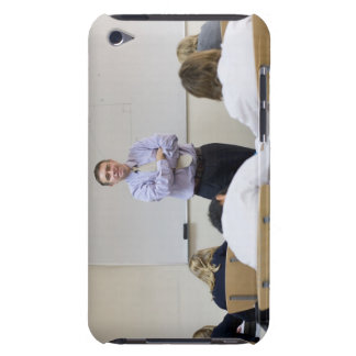 Teacher at front of class, children working hard iPod touch covers