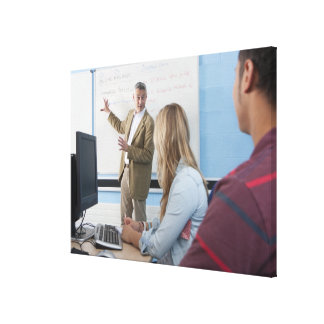 Teacher at whiteboard explaining lesson to canvas print