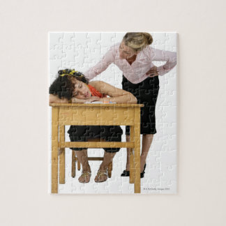 Teacher Checking on Student Asleep at Desk Jigsaw Puzzle