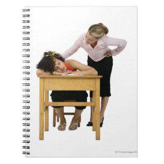 Teacher Checking on Student Asleep at Desk Notebook