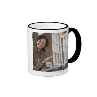 Teacher giving paperwork to student coffee mug