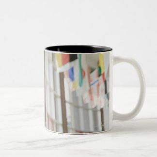 Teacher giving paperwork to student Two-Tone mug
