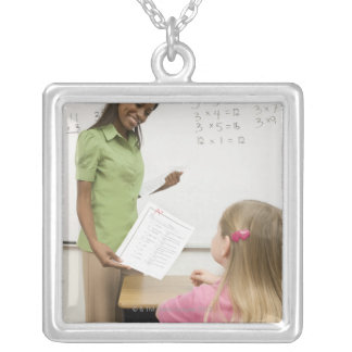 Teacher handing paper to student with A plus Silver Plated Necklace