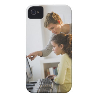 Teacher helping student in computer lab iPhone 4 Case-Mate case