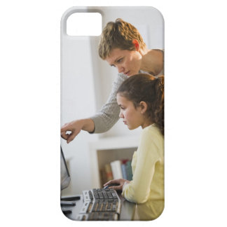 Teacher helping student in computer lab iPhone 5 cases