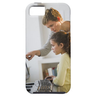 Teacher helping student in computer lab iPhone 5 covers