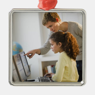 Teacher helping student in computer lab Silver-Colored square decoration